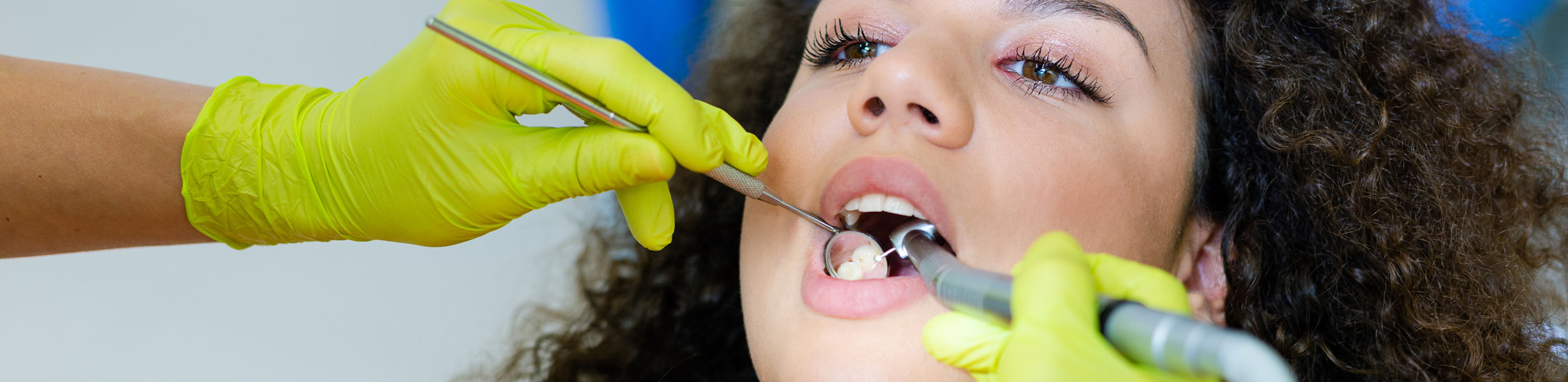 Woman having surgery at dental clinic